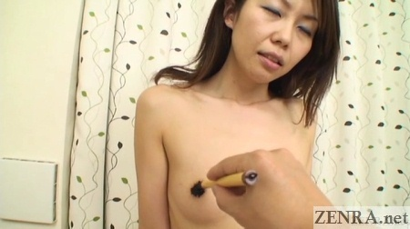 aroused naked japanese woman nipples painted with calligraphy ink