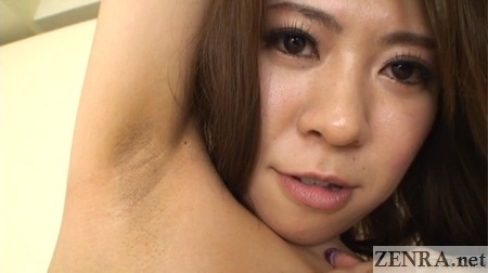 very cute japanese woman shows armpit