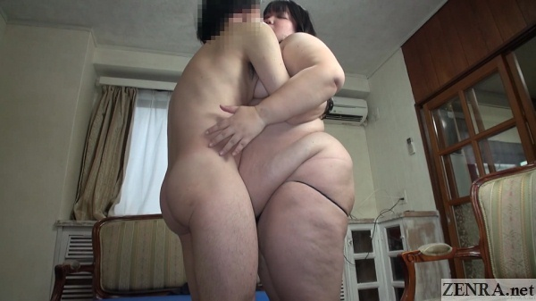skinny man embraces naked fat woman