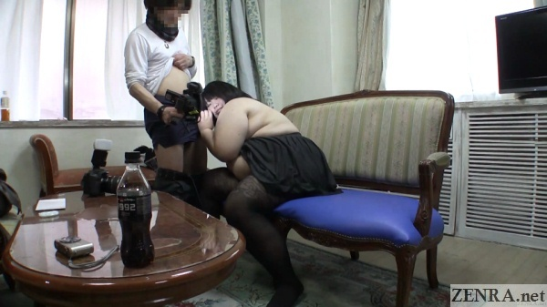 chunky japanese woman nuzzles erection