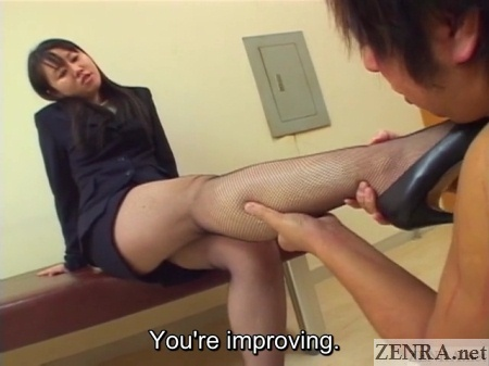 slave gives mistress a leg massage