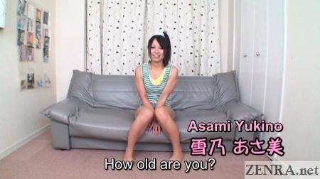 asami yukino tan and seated