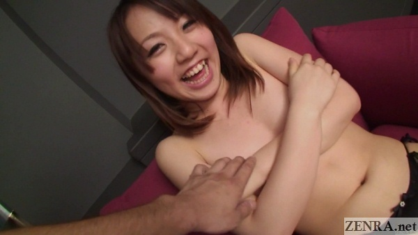 shy topless japanese woman covers chest