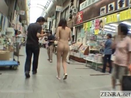 japanese nudist walking through shopping arcade