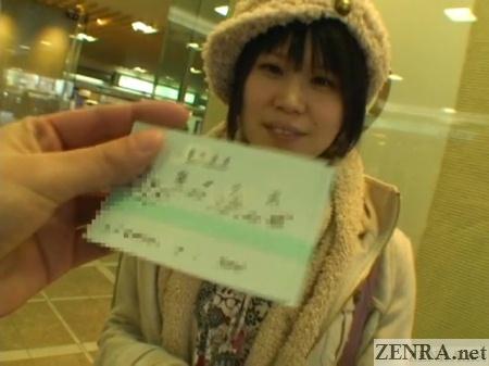 shinkansen ticket handed to short hair japanese woman