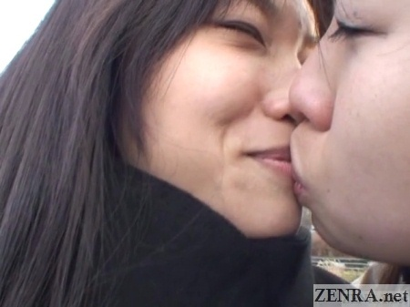 japanese lesbians kiss outdoors on wintry day