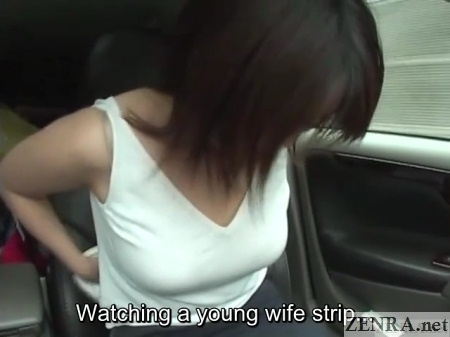 young japanese wife prepares to strip in car
