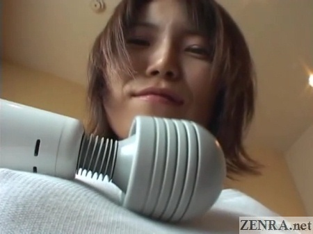 massager placed against bra less japanese wife