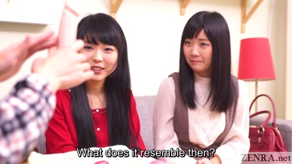 japanese friends look at lifelike dildo