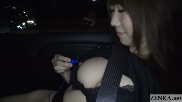 hitomi oki places small vibrator against a nipple