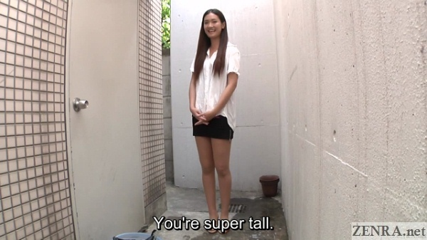 very tall japanese woman in alley way