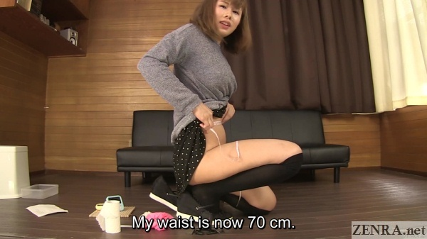 panty less japanese woman measures waist after peeing