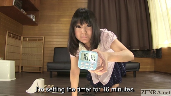 japanese woman holds timer