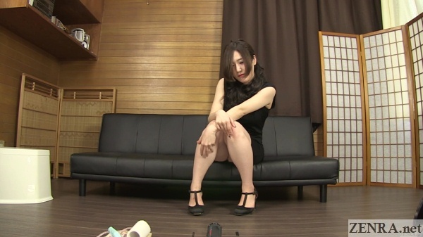 beautiful japanese woman tries to hold in pee