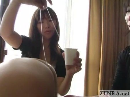 japanese woman drip lotion over anus of naked man