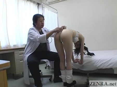 exposed pale schoolgirl bent over by clothed doctor