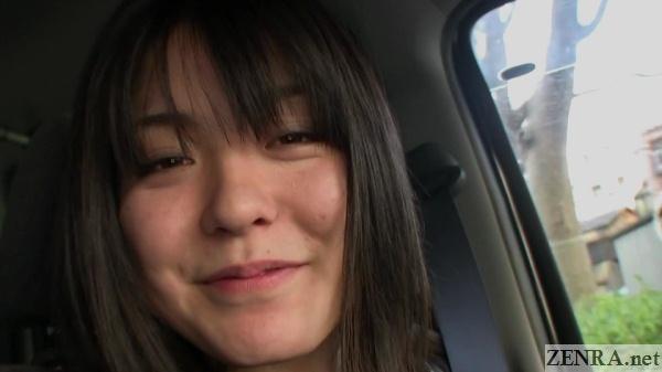 mao suzuki smiling in car