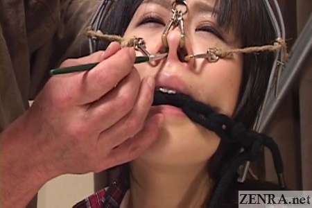 brushes into expanded nostrils of japanese av star