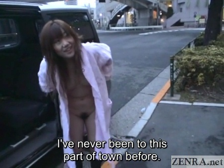 japanese woman in bathrobe prepares to drop it for public nudity