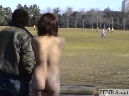 clothed man naked woman watches soccer