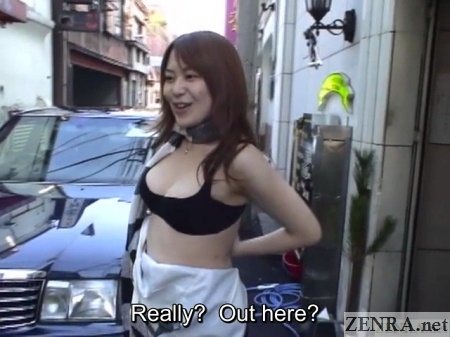 japanese hostess prepares to drop bra outside