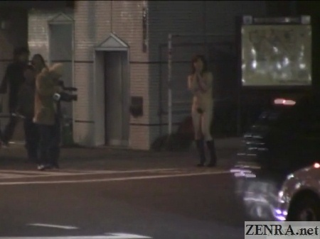 stark naked japanese woman waits for stop light to change