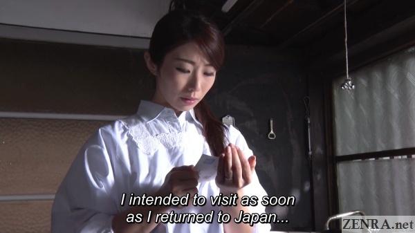 ayumi shinoda reads letter in kitchen