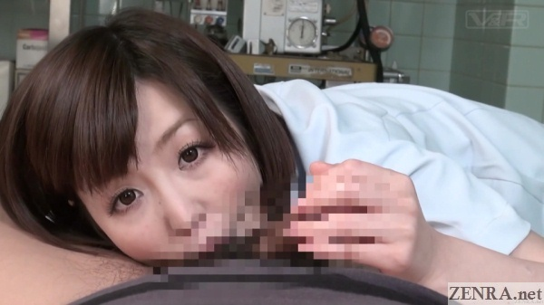 female doctor sucks on patients testicles during handjob