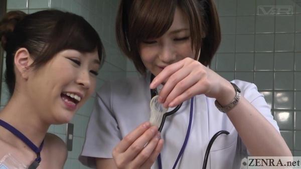 female doctors admire full condom
