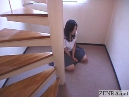 japanese schoolgirl resting by staircase