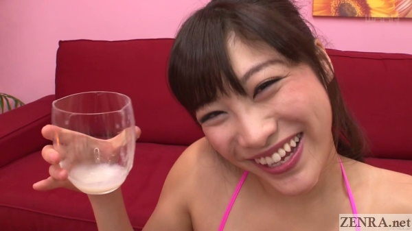 smiling miki sunohara holds glass of cum