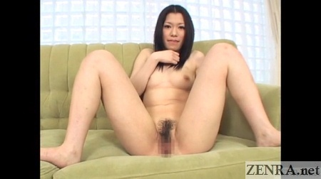 pale spread wide japanese woman on green sofa