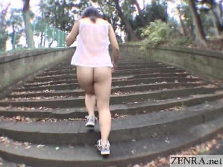 bottomless japanese woman walking up stairs outside