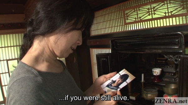 older japanese woman looks at photograph of mizuna rei