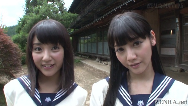 japanese schoolgirls posing by old house