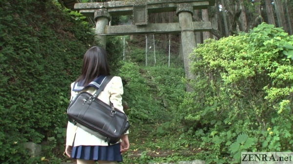 japanese schoolgirl reaches mountain shrine