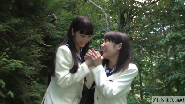 cheerful japanese schoolgirls on forest trail
