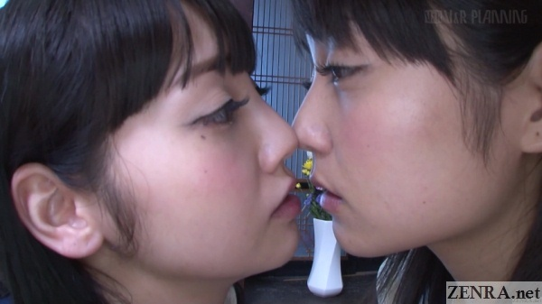 japanese schoolgirls moments away from kissing