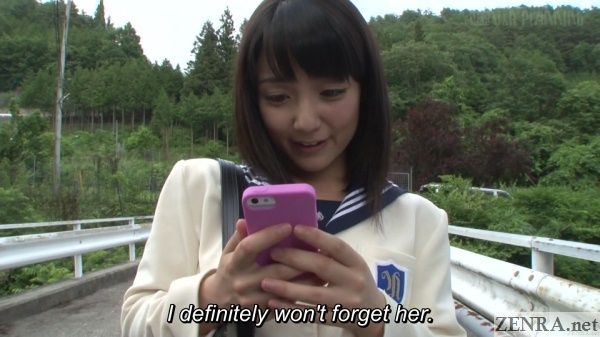 sayo arimoto looks at favorite picture on smartphone