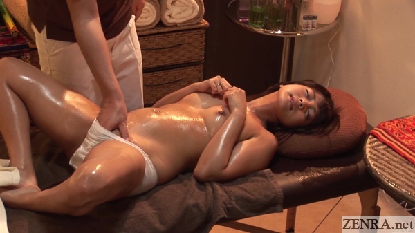 supine topless erotic japanese oil massage with fingering