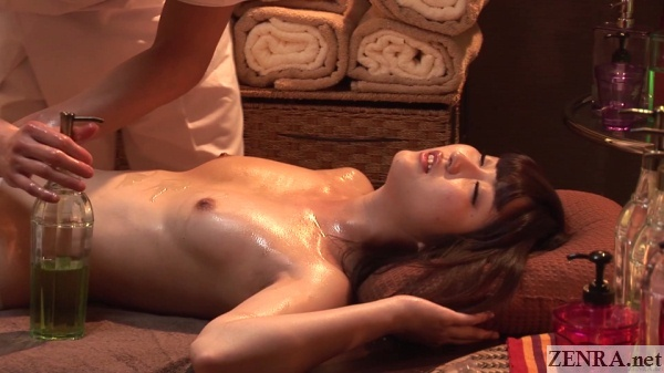 aroused japanese woman topless oil massage
