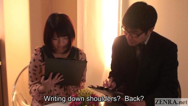 japanese couple filling out massage questionnaire