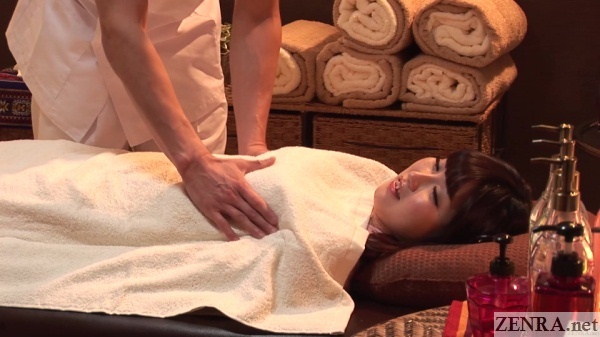 japanese masseur feels breasts of client
