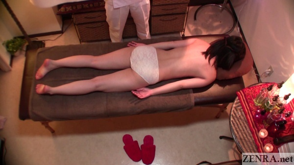 prone japanese woman awaits oil massage