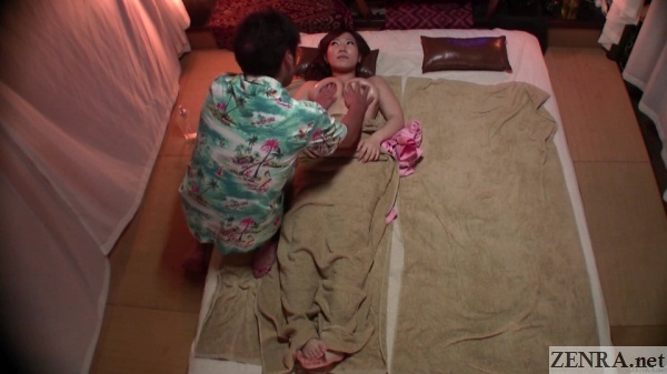 topless japanese breast massage overhead view