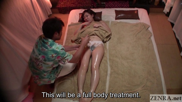supine japanese woman coated in oil