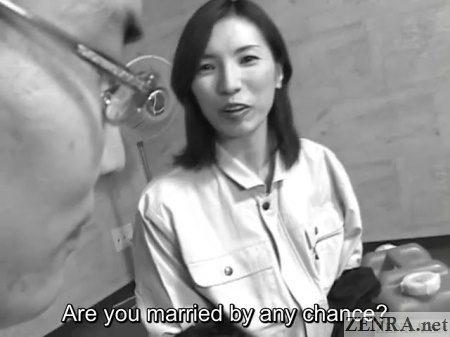 female japanese boss asks coworker about marriage