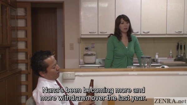 older japanese couple discussing worries in kitchen