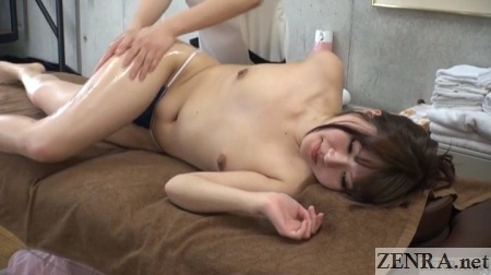 sideways oil massage for topless japanese woman