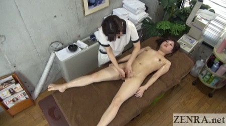 stark naked supine female client receives internal vagina massage by clothed therapist